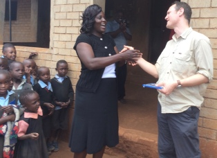 Sam meeting Kipsaina Primary staff and pupils in 2017