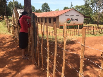 """Sharon Wanjala tackling the Kipsaina Primary """"Gate"""" - to be replaced as part of phase 2"""