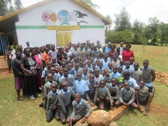 Gathering to celebrate handing over of the classroom block - Roll of honour on the gable end